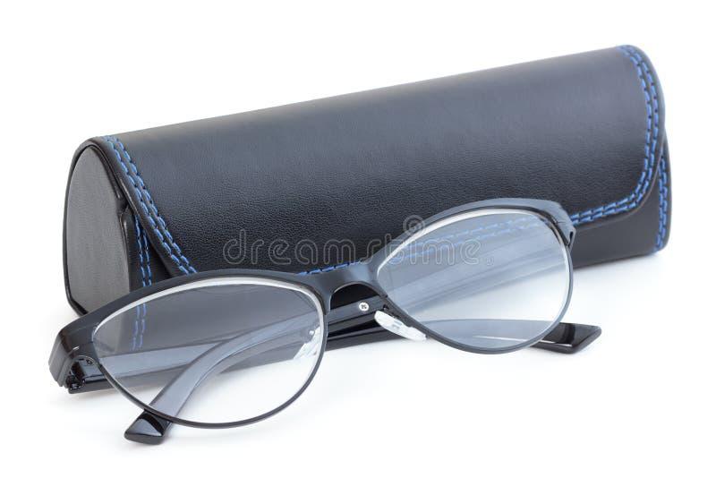 Optiska exponeringsglas med piskar fallet på vit bakgrund royaltyfri foto