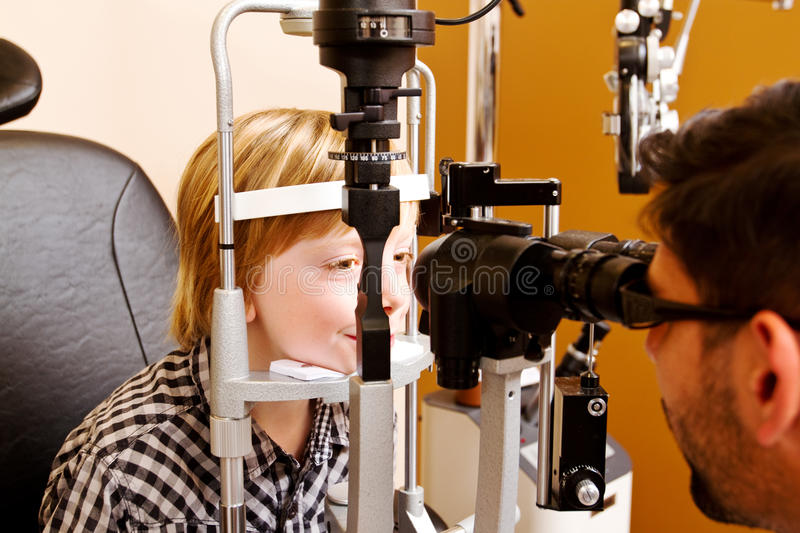 Optometrist checking childs vision stock images