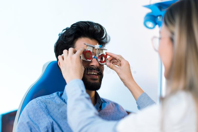 Optometrist checking patient eyesight and vision correction royalty free stock photo