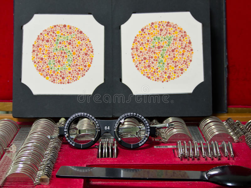 Optometry lens, eyeglasses and color blind test. In hospital stock photo