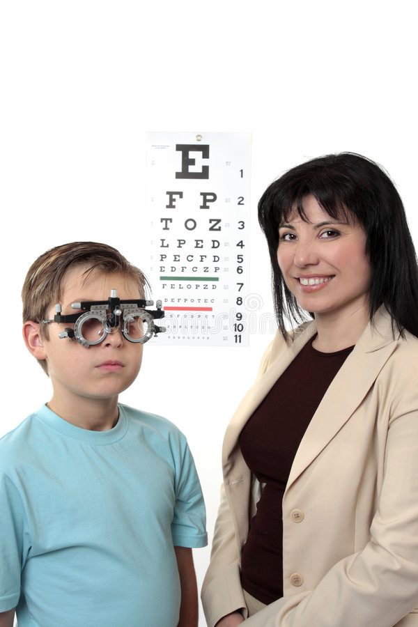 Optometstrist givine eye examination stock image