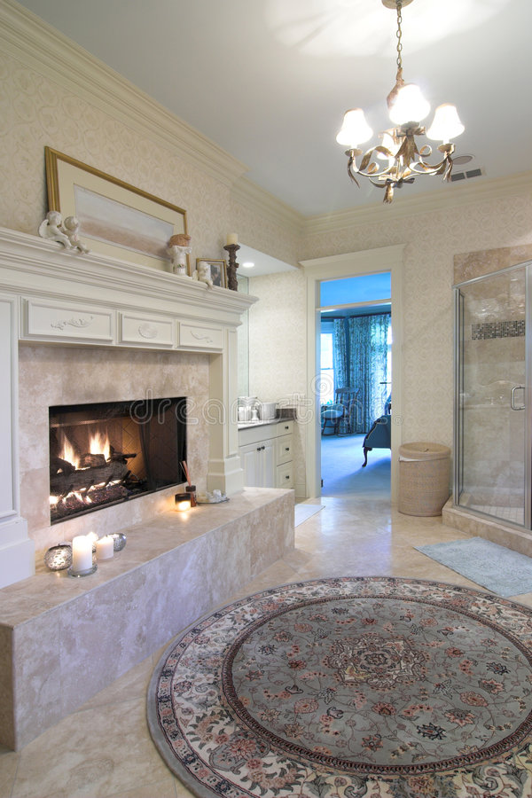 Opulent bathroom. With fireplace and glass shower stock photo