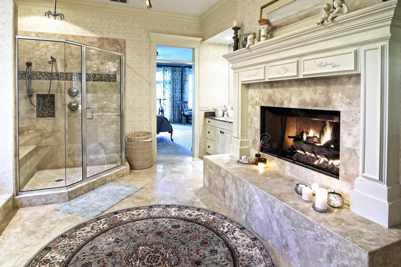 Opulent bathroom 50. Opulent bathroom with fireplace and glass shower royalty free stock image