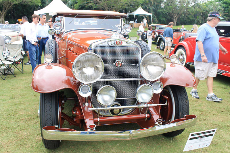 Opulent classic american car front view. Showing car's headlamp and grill. 1930 Cadillac 452 v-16 roadster around people at show royalty free stock image