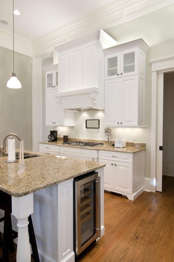 Opulent white kitchen. With granite countertops and wine fridge stock photo