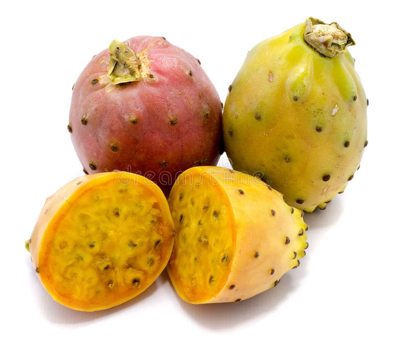 Opuntia prickly pear isolated. Group of two whole and sliced prickly pears, opuntia red, green and yellow, flesh with seeds, two halves, isolated on white stock image