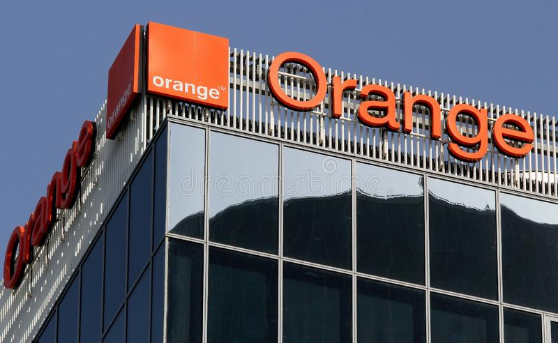 Orange logo, in Bucharest, Romania. Bucharest, Romania - October 17, 2018: A logo of Orange, French telecommunications company, is displayed on the top of a royalty free stock image