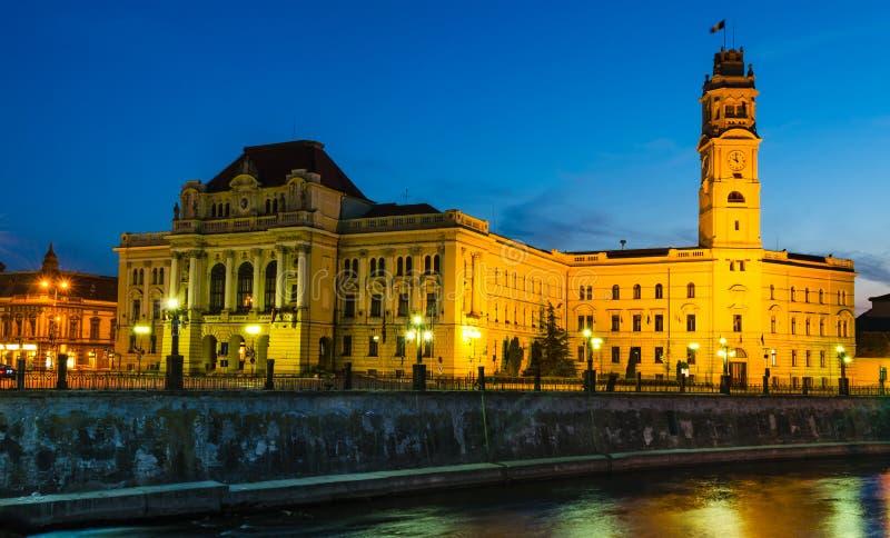 Oradea twilight, Romania. Twilight image with Oradea city-hall and the Clock Tower, built with neo-classic frontispiece. Romania, Transylvania royalty free stock photography