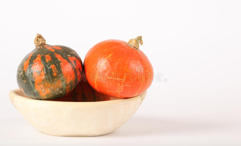 Orage and green pumpkins royalty free stock images