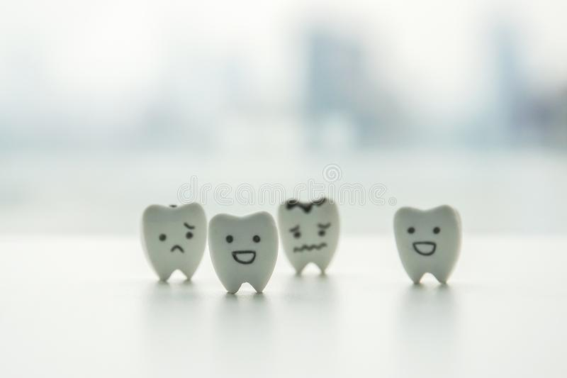 Oral health icon - isolated healthy teeth and decayed teeth cartoon with smiley and sad face. For kid education stock photo
