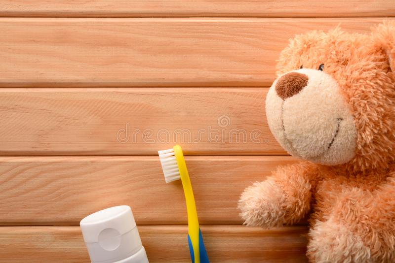 Oral hygiene for children with toothbrush and toy on table stock photos