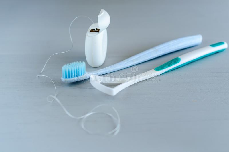 Oral hygiene health concept. Closeup dental tools toothbrush and tongue cleaner royalty free stock photos