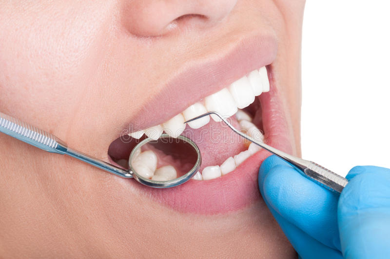 Oral hygienist at work. Using dentist tools royalty free stock photo