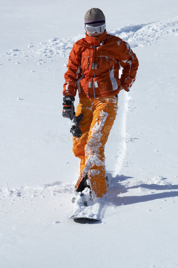 Orang snowboard girl royalty free stock photo