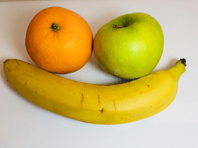 Orange, äpple och bananer royaltyfria bilder