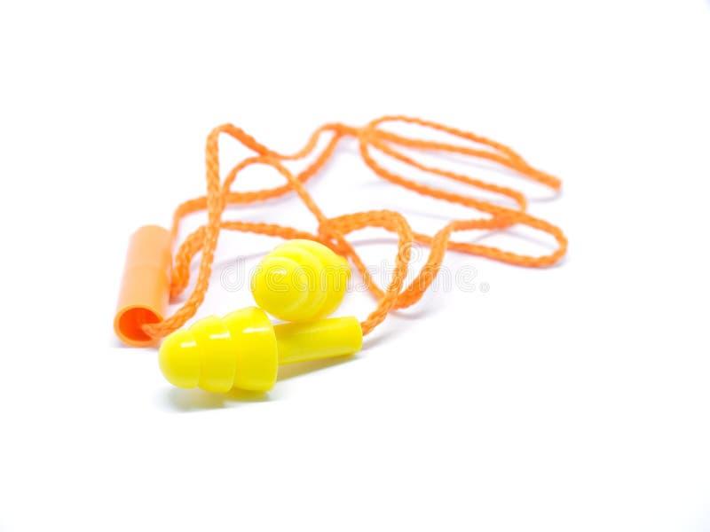 Orange öraproppar för närbild på vit bakgrund arkivfoton