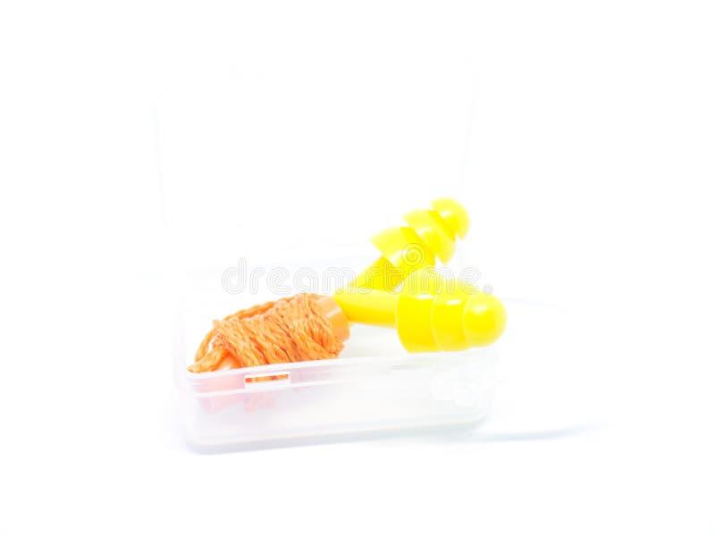Orange öraproppar för närbild på vit bakgrund royaltyfri fotografi