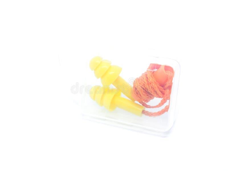 Orange öraproppar för närbild på vit bakgrund arkivfoto