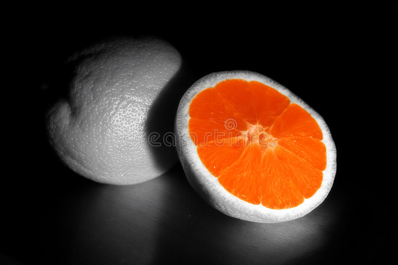 Orange. An Orange that was made into black and white, except for the inner part royalty free stock photography