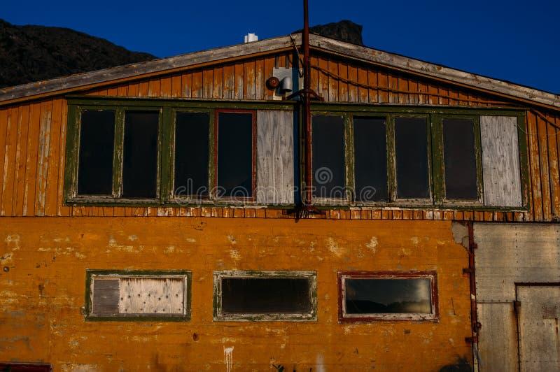 Orange abandoned factory building, Lofoten Islands. Norway royalty free stock photo
