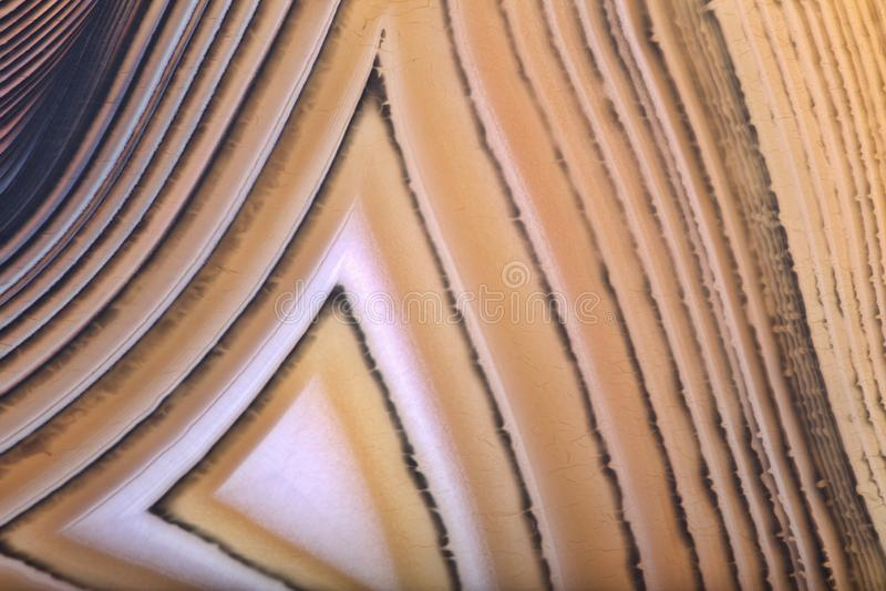 Orange agate triangle texture macro. Background with contrast agate structure royalty free stock photos