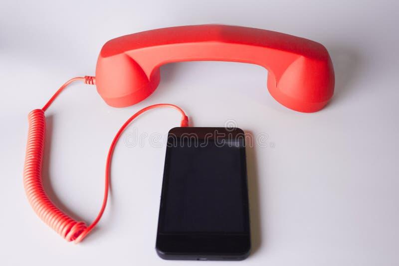 Orange analog phone and smartphone royalty free stock photo
