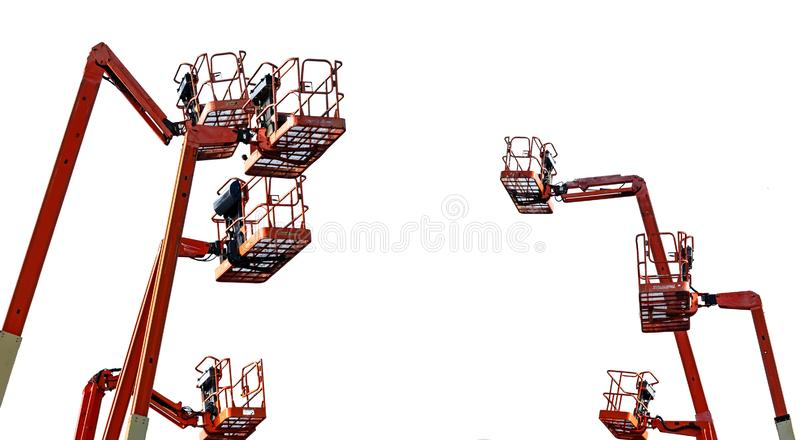Orange articulated boom lift. Aerial platform lift. Telescopic boom lift isolated on white background. Mobile construction crane royalty free stock image