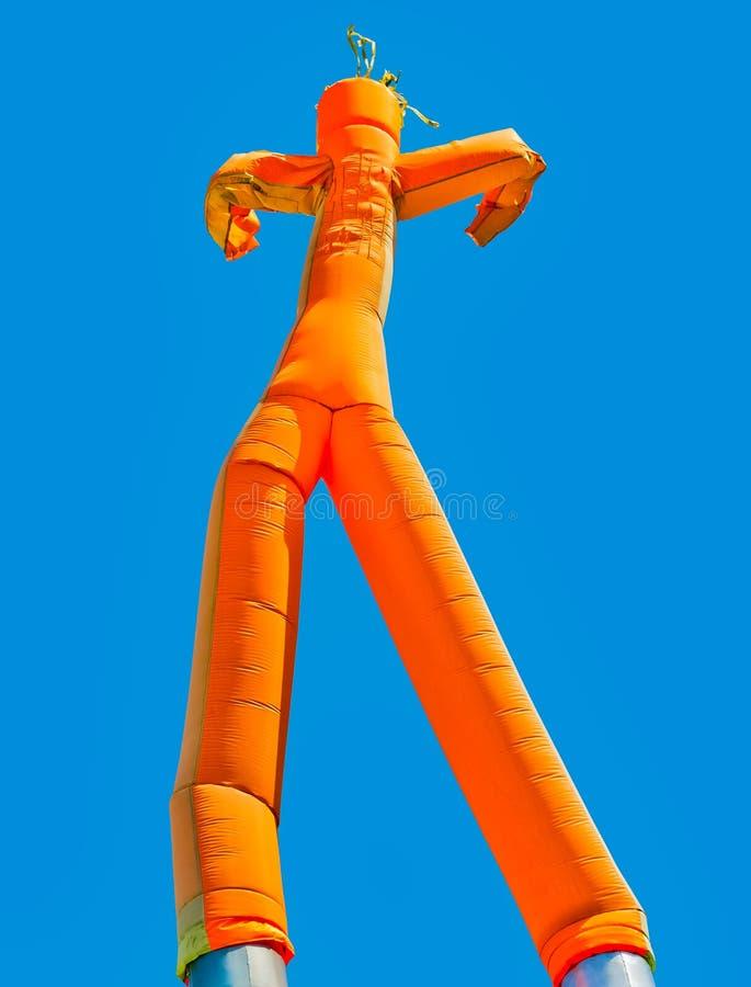 Orange aufblasbarer Mann lizenzfreies stockbild