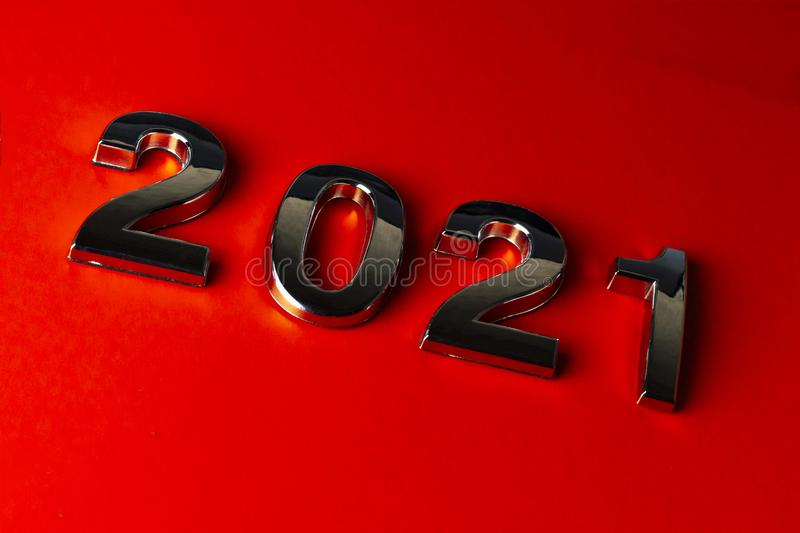 Orange background. close-up. the laid out numbers 2021. metallic luster. Christmas, concept, happy, holiday, year, anniversary, business, calendar, card stock photo