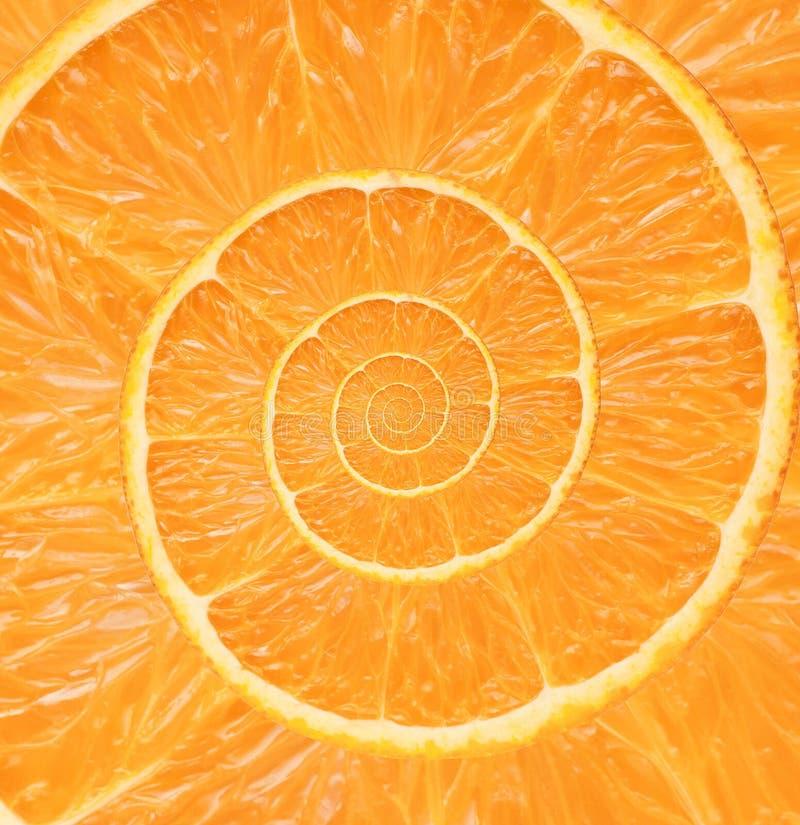 Orange bakgrund för oändlighetsspiralabstrakt begrepp. royaltyfri foto