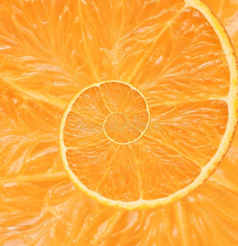 Orange bakgrund för oändlighetsspiralabstrakt begrepp fotografering för bildbyråer