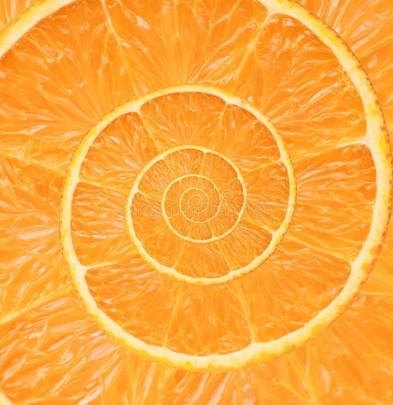 Orange bakgrund för oändlighetsspiralabstrakt begrepp arkivbilder