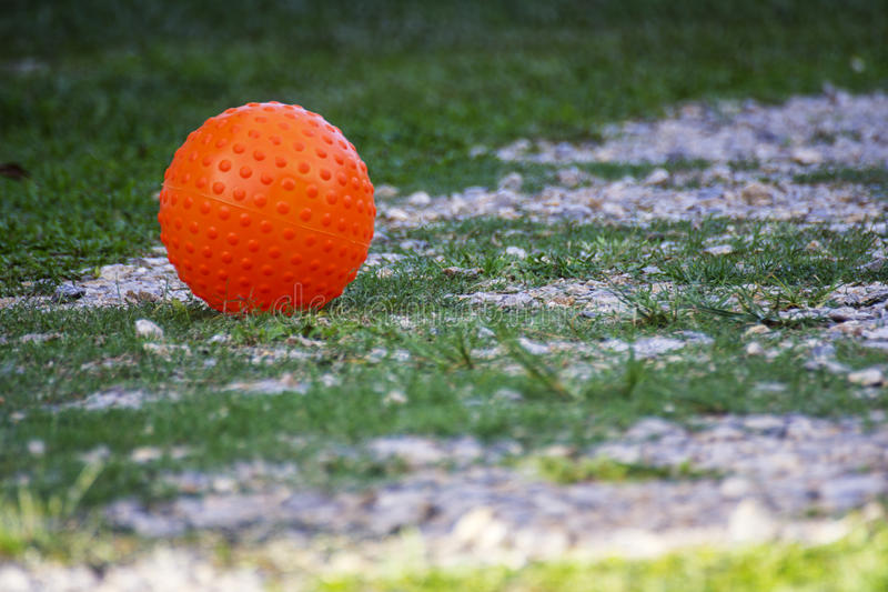 Orange ball on ground.  stock images