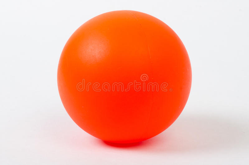 Orange Ball. An orange plastic ball used for street hockey royalty free stock photo