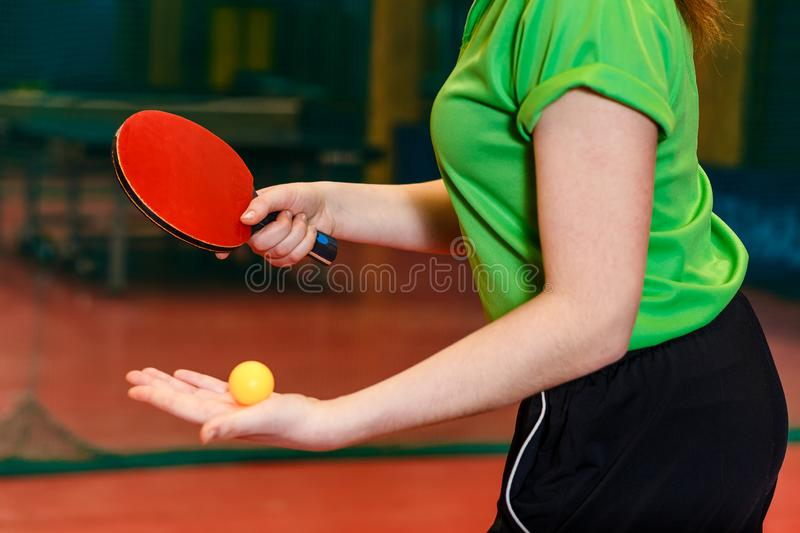 Orange ball for table tennis lies in the palm of a young athlete. the beginning of the game ping pong close royalty free stock photos