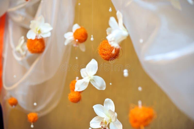 Orange balls and white flowers royalty free stock photo