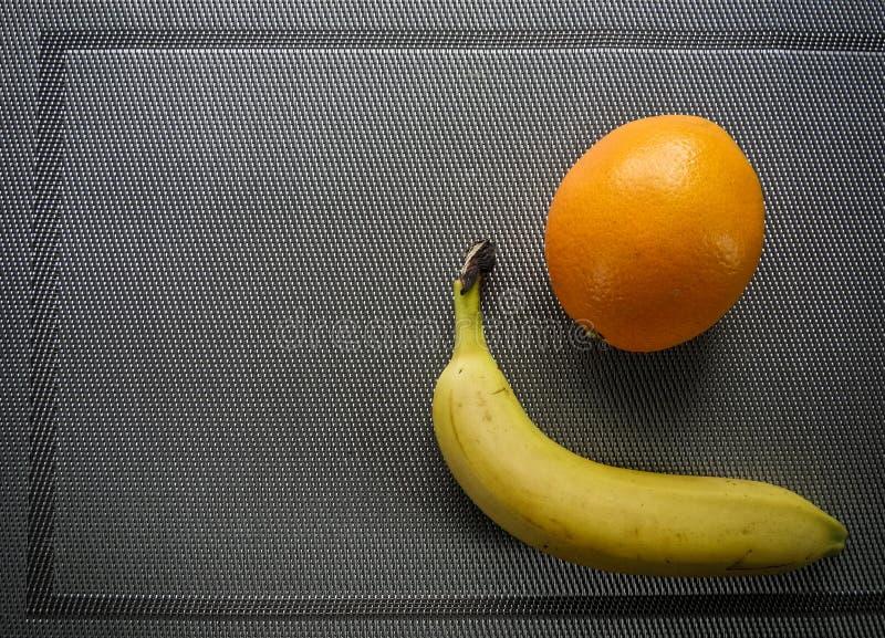 Orange banana, tropical fruits on the table stock photography