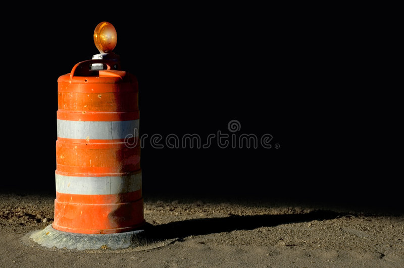Orange barricade. With black background. Add your own copy or text stock images