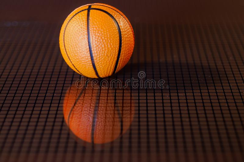 Orange basket ball and his reflected image royalty free stock image