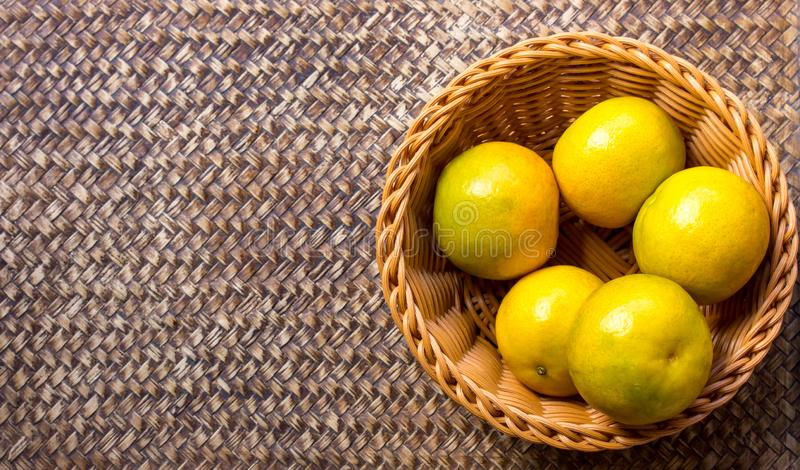 Orange in the basket. On a beautiful background stock image