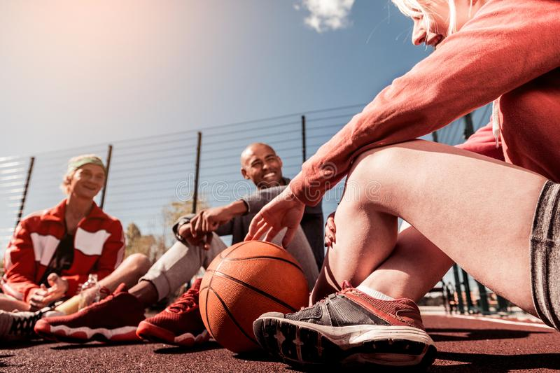Orange basketball ball lying on the ground royalty free stock image