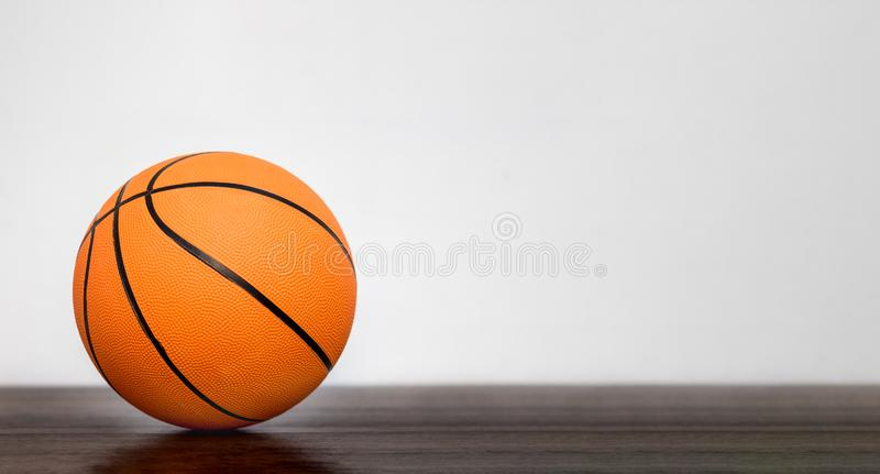 Orange basketball ball in the sports hall on blurry background.Copy space_. Orange basketball ball in the sports hall on blurry background.Copy space royalty free stock images