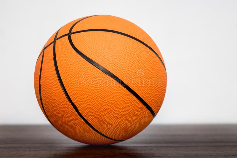 Orange basketball ball in the sports hall on blurry background_. Orange basketball ball in the sports hall on blurry background stock image