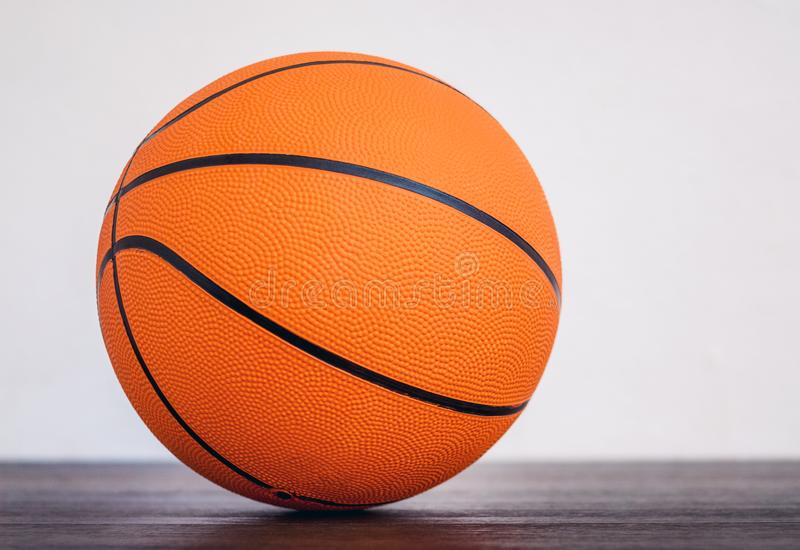 Orange basketball ball in the sports hall on the floor on blurry background_. Orange basketball ball in the sports hall on the floor on blurry background royalty free stock images