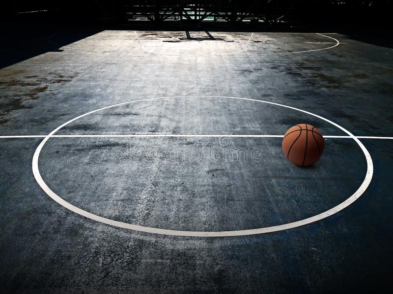 Orange basketball on court in gymnasium sport competition floor background stock photos