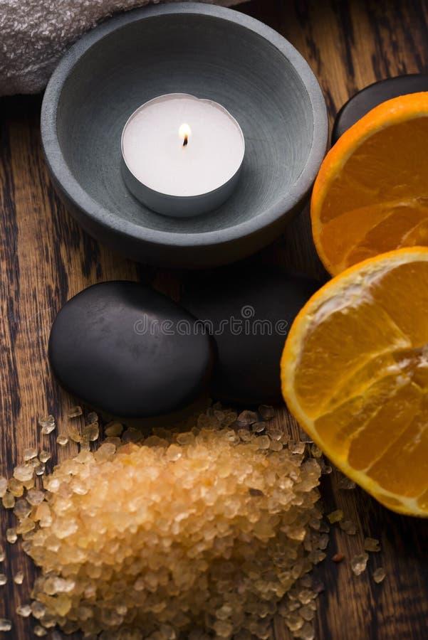 Orange bath salt and fruits stock photography