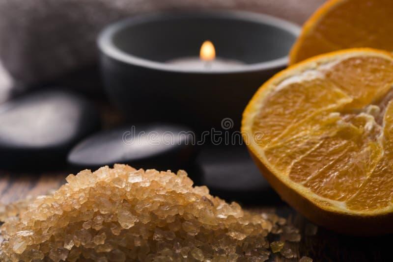 Orange bath salt and fruits stock photos