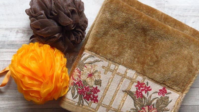 Orange Bath Sponge, Brown Bath Sponge, Ochre Colour Towel. stock images