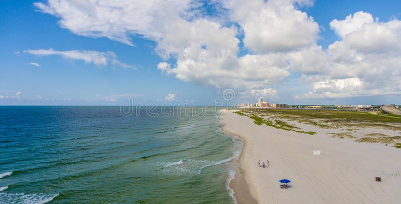 Orange Beach, Alabama on the Gulf Coast. Seascape, shores, aerial, view, sand, summer, baldwin, waves, travel, vacation, blue, sky, clouds stock photography