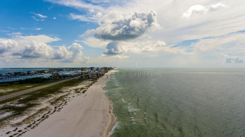 Orange Beach, Alabama on the Gulf Coast. Seascape, shores, aerial, view, sand, summer, baldwin, waves, travel, vacation, blue, sky, clouds, resort royalty free stock images